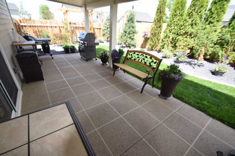 Patio concrete overlay resurface with custom design and color and patio cover