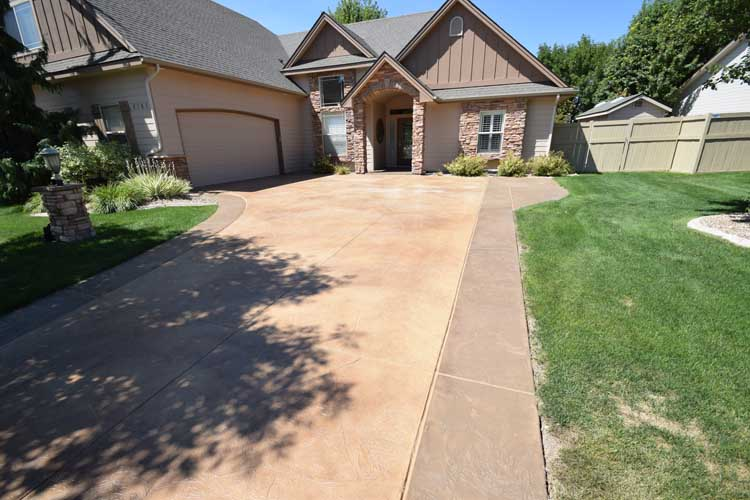 Driveway concrete overlay resurface with custom design and color and patio cover