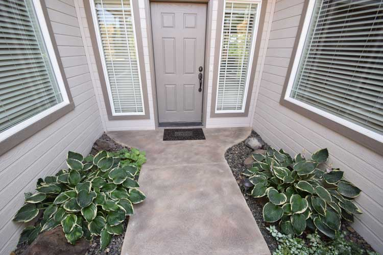 Patio concrete entry resurface with custom design and color and patio cover