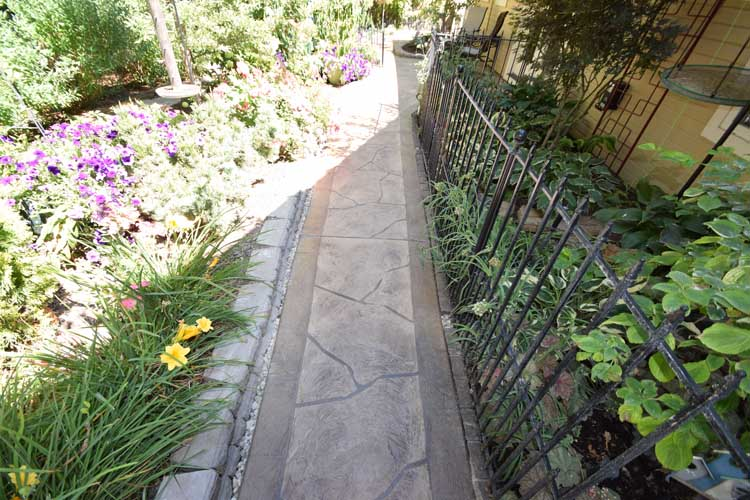 Patio concrete walkway resurface with custom design and color and patio cover